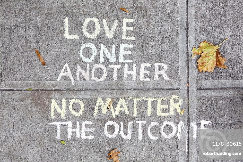 Chalk message on sidewalk