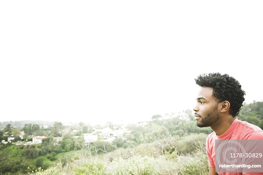 African American man sitting on hilltop