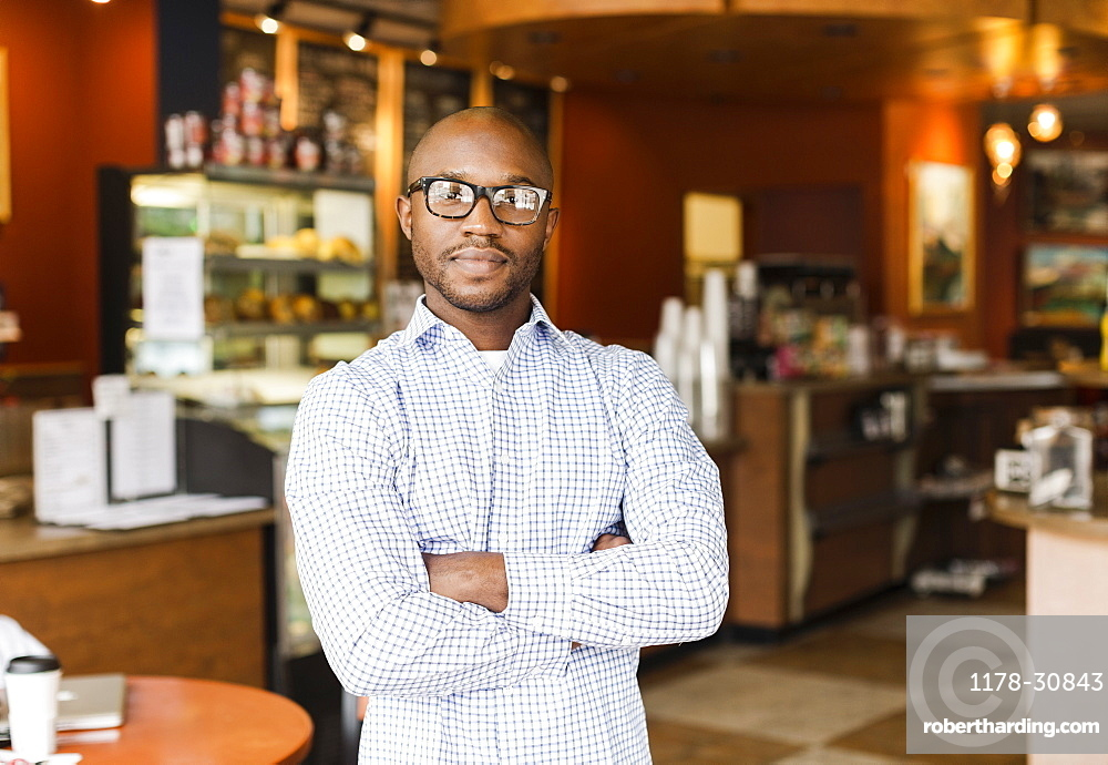 Black man standing in coffee shop