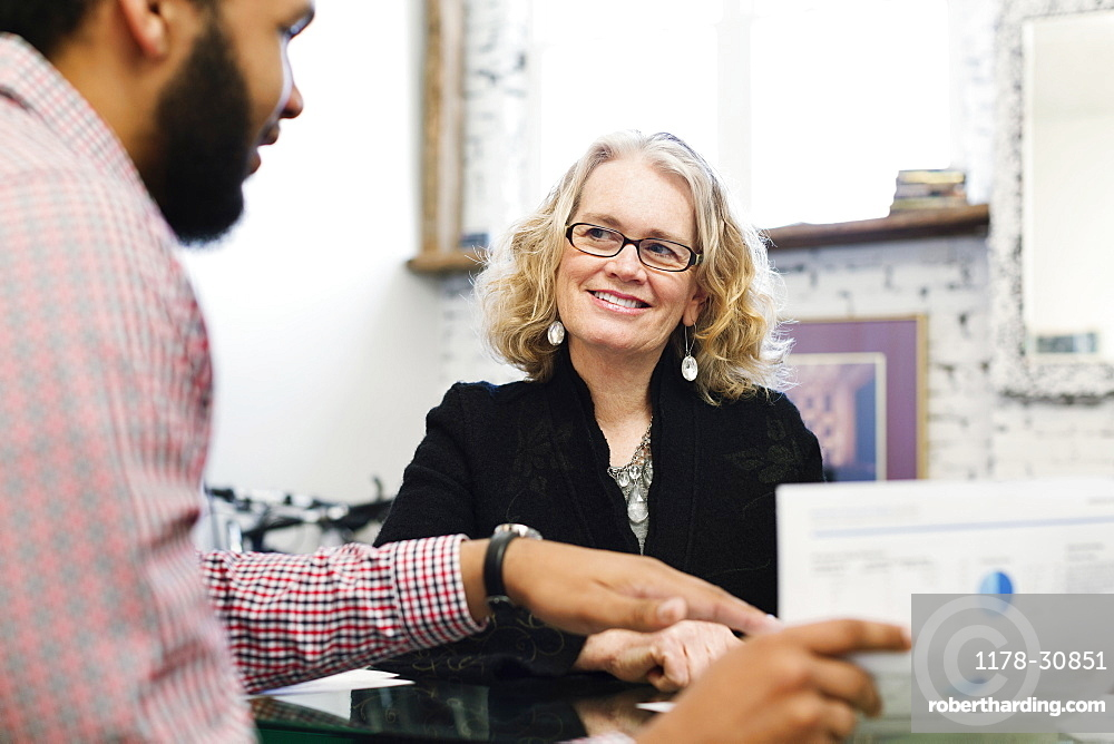 Businesswoman talking to young businessman