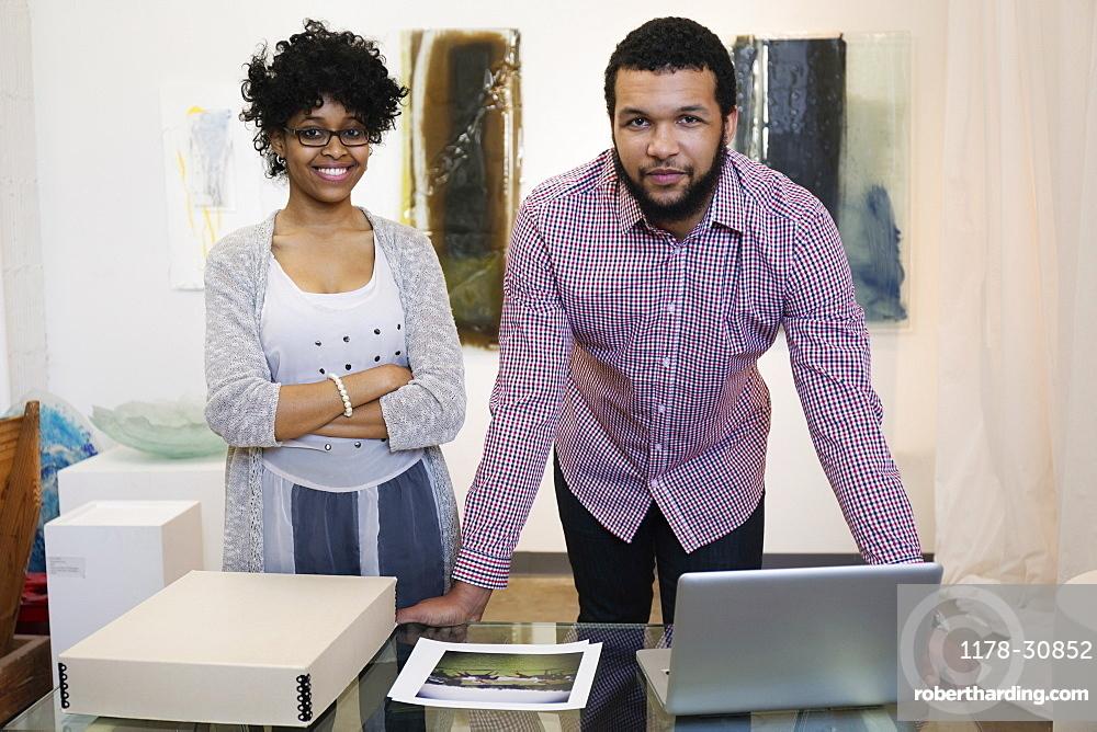 Business people working in art gallery