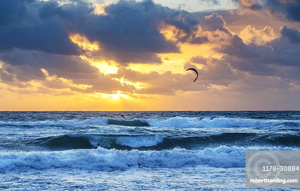 United States, Florida, Delray Beach, Kite surfer in ocean at sunrise