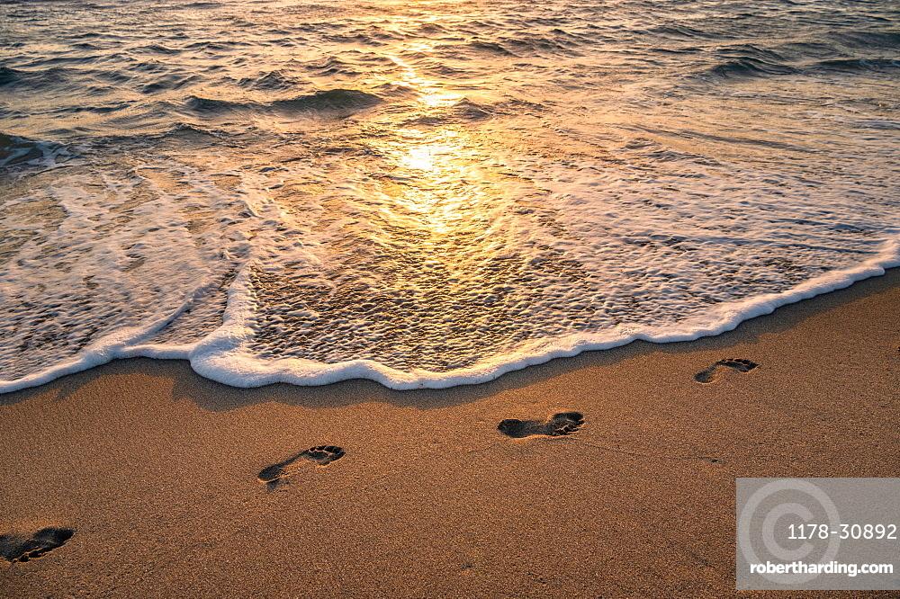 United States, Florida, Boca Raton, Footprints on beach at sunset
