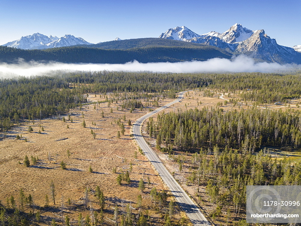 United States, Idaho, Landscape with forests and Sawtooth Mountains in snow