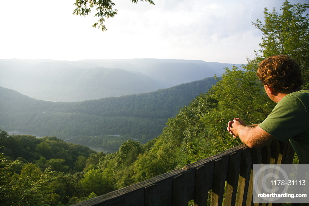 Mid adult man looking at view from viewing platform, rear view, New River Gorge National River, Fayetteville, West Virginia, USA
