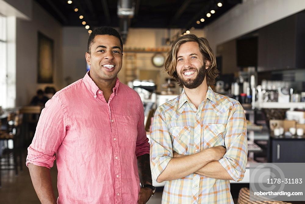 Portrait of two men in coffee shop