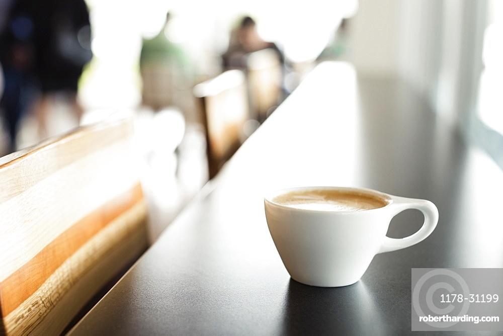 Fresh coffee on counter in coffee shop
