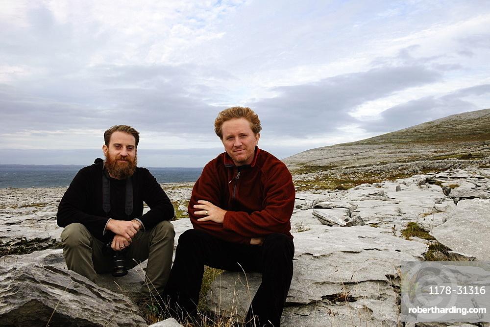 Two men sitting on rocks, The Burren, County Clare, Ireland