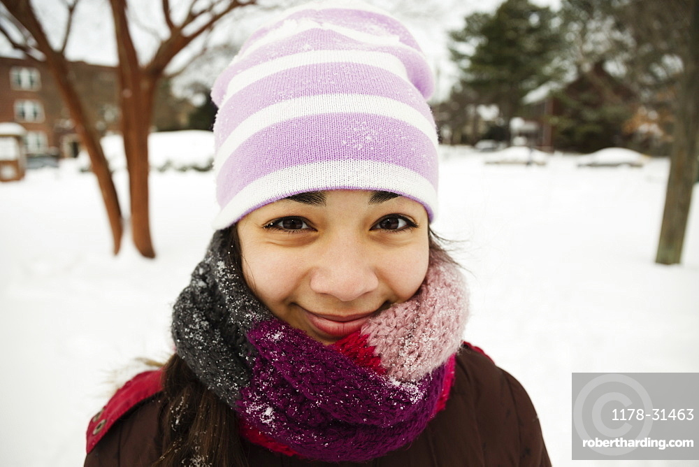 Portrait of teenage girl wrapped up for winter snow