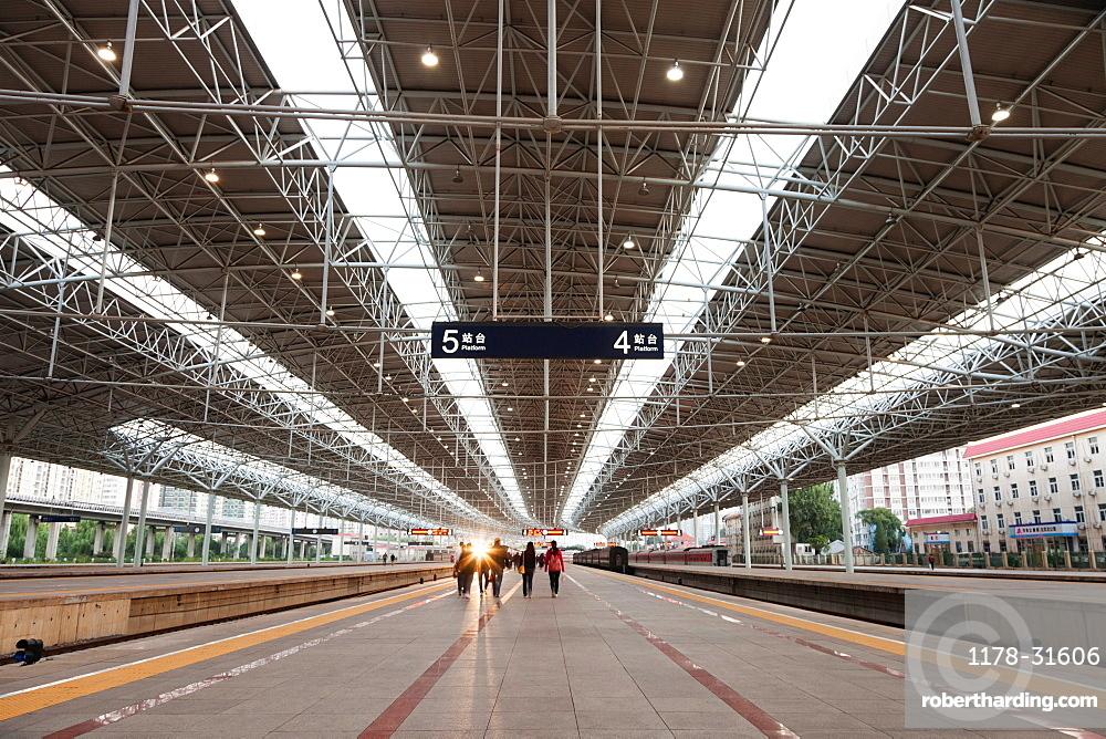 People on Beijing train station platform