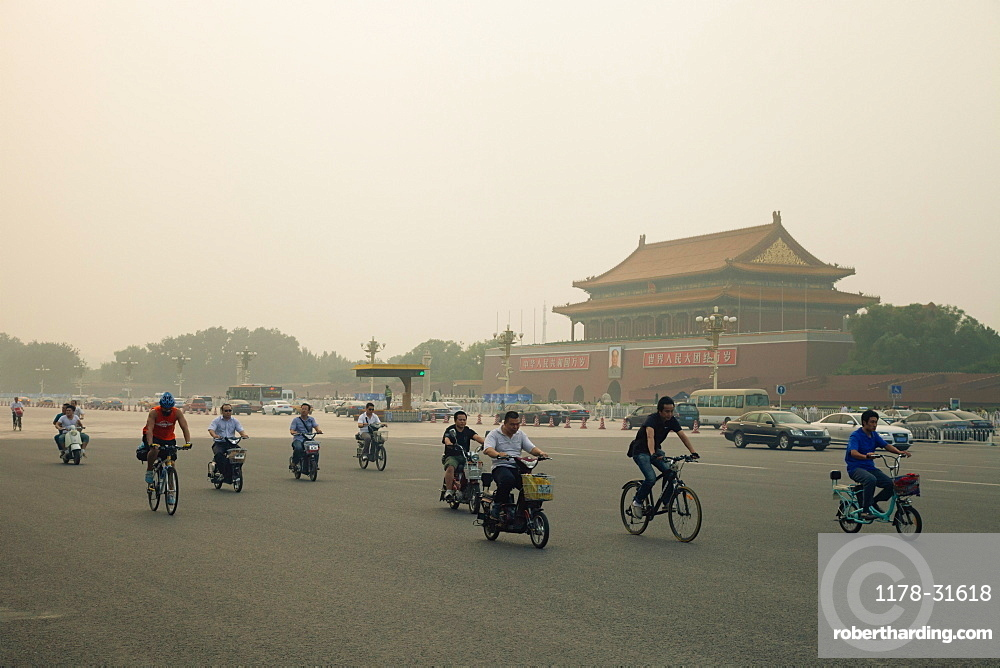 People bicycling in Tiananman Square