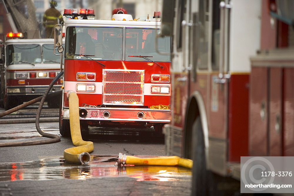 Firetrucks parked with hoses