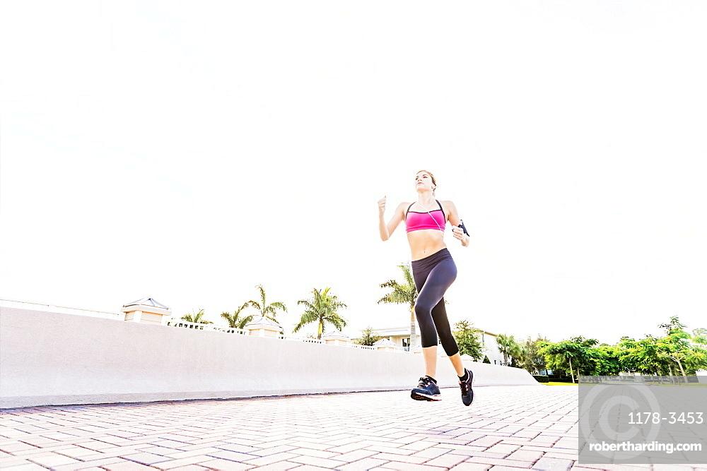 Woman running along promenade, Jupiter, Florida