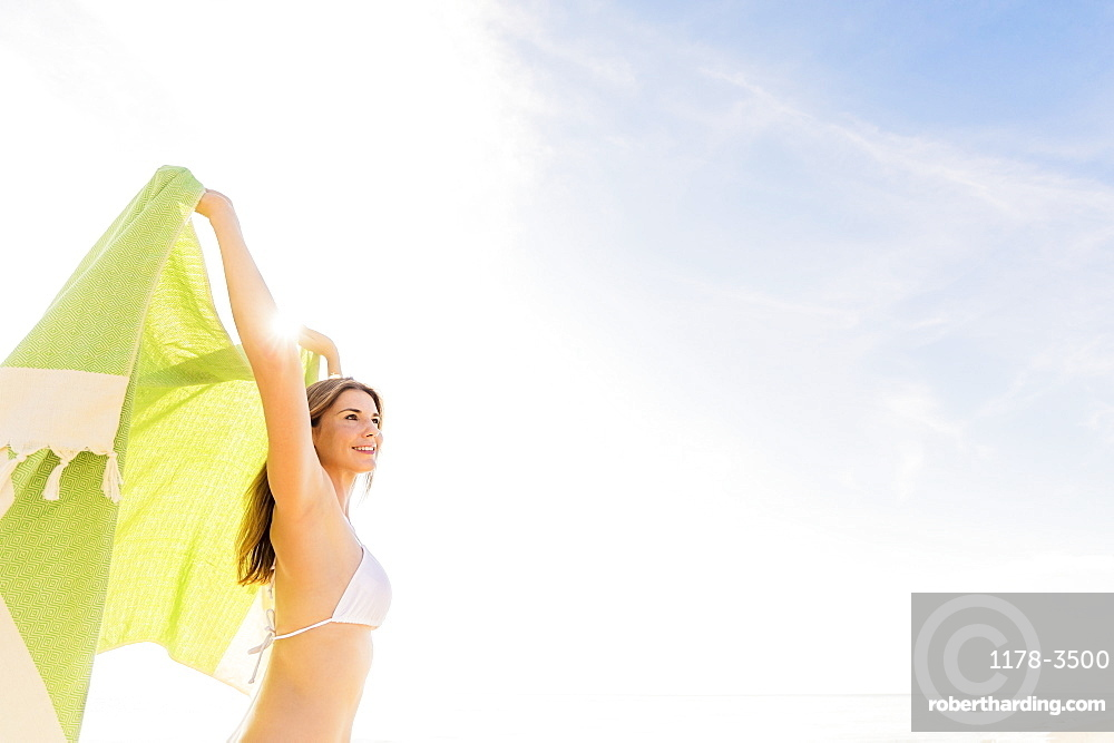 Woman holding green towel