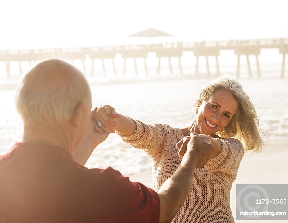 Senior couple dancing on beach, Jupiter, Florida