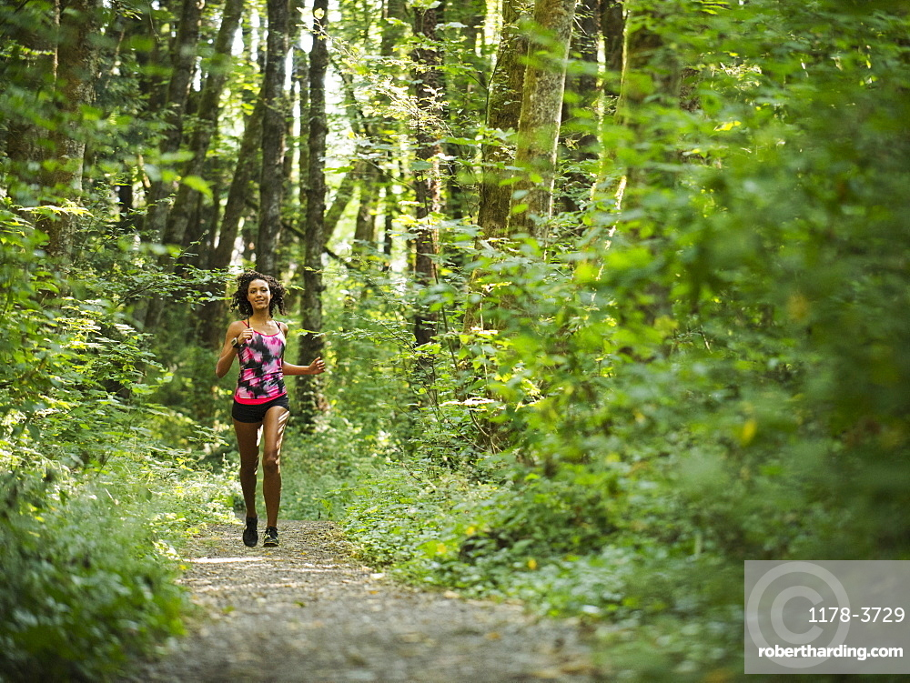 Young women jogging in forest, USA, Oregon, Portland