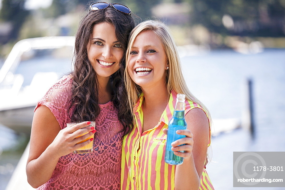 Portrait of young women posing with drinks, USA, Washington, Bellingham
