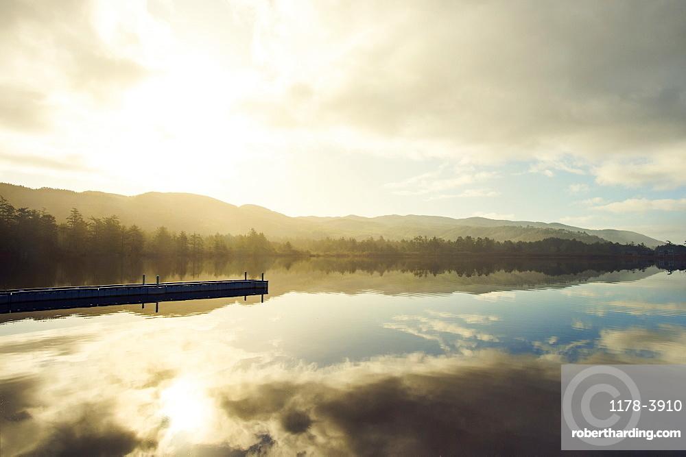 Landscape with sky reflected in water, Rockaway Beach, Oregon