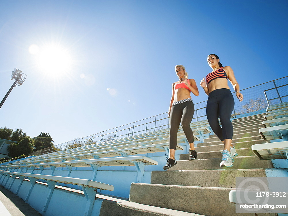 Two women walking down steps, USA, California, Los Angeles