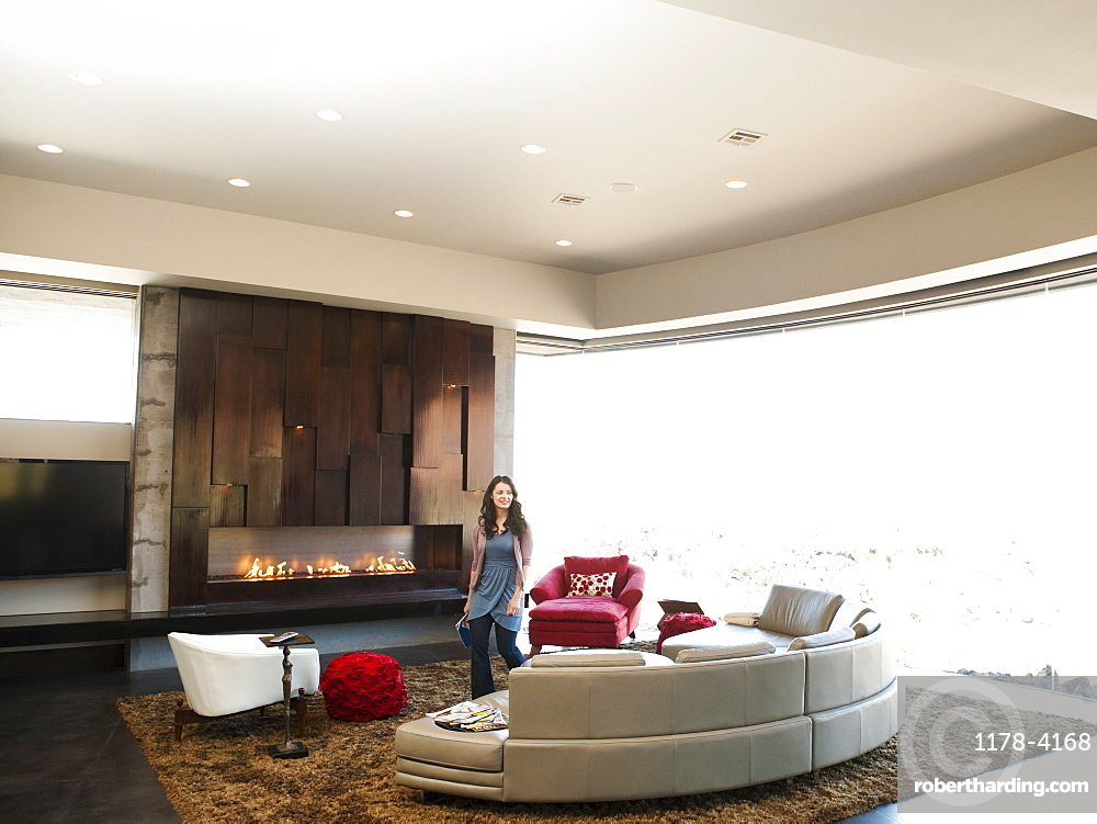 Young woman bustling in modern living room