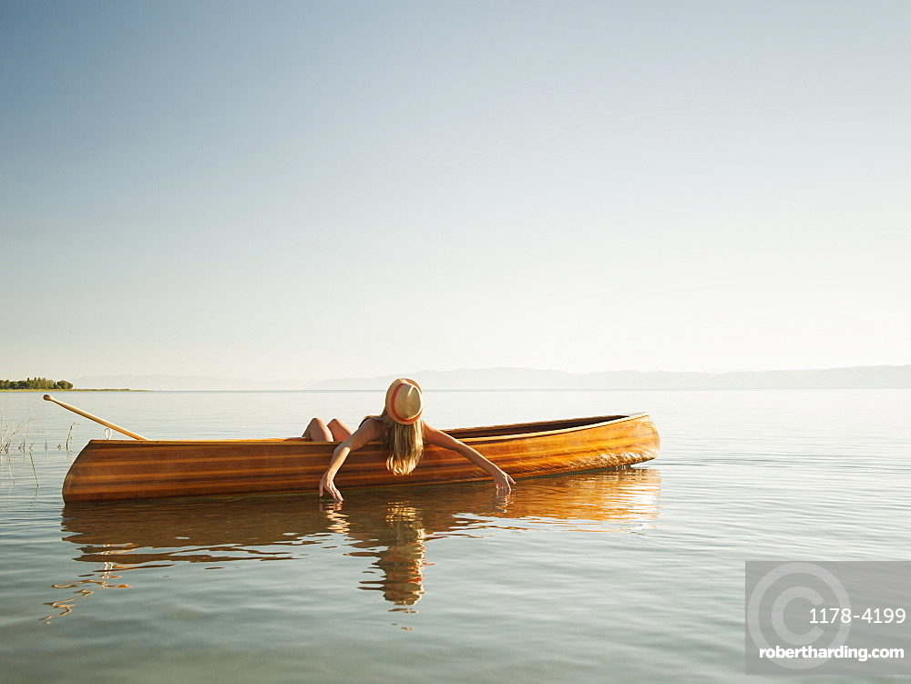 Young woman relaxing in canoe