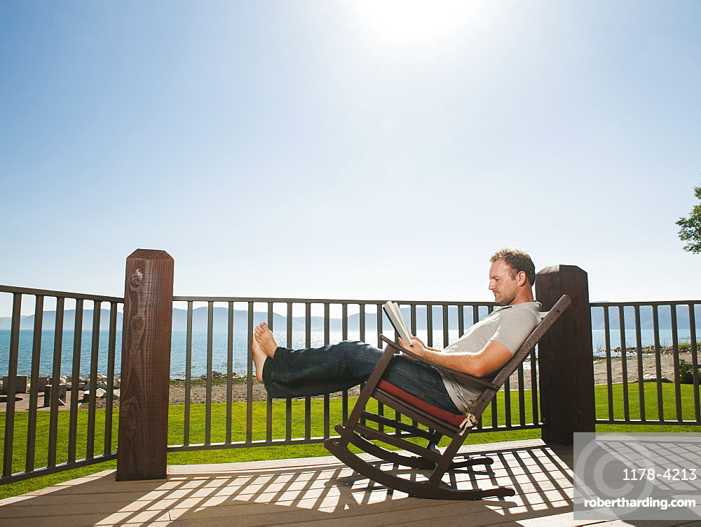 Mid-adult man relaxing on rocking chair, USA, Utah, Garden City