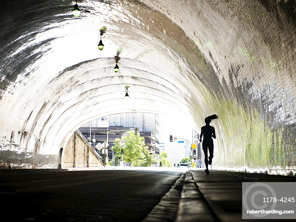 USA, California, Los Angeles, Woman running in tunnel, USA, California, Los Angeles