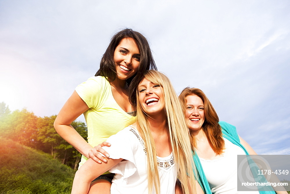 Portrait of three young women hanging out