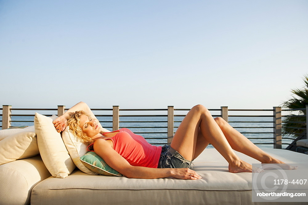 Young attractive woman sunbathing