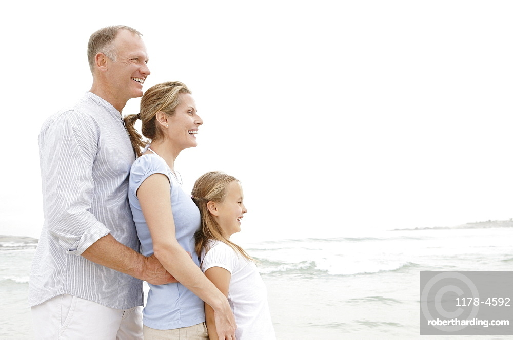 Family standing on beach
