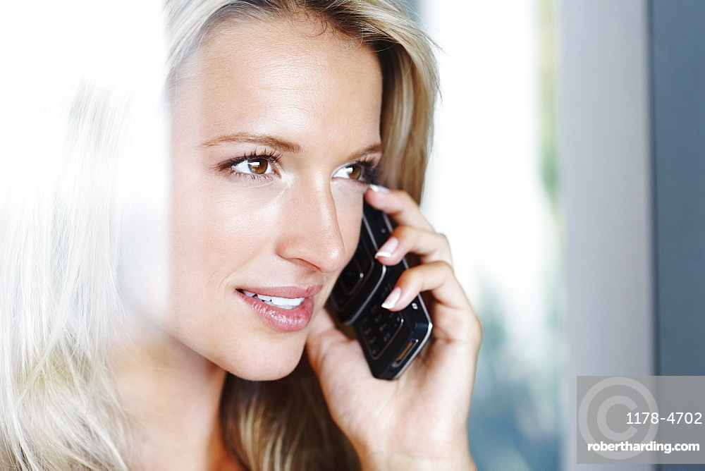 Woman talking on cellular phone