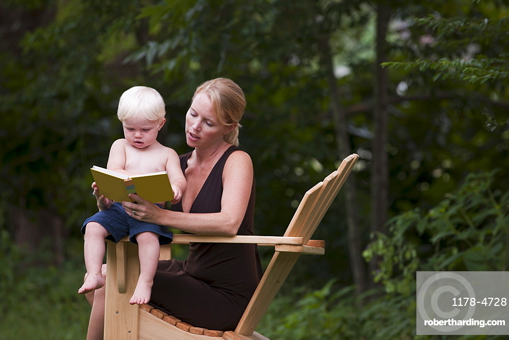 Woman reading to son