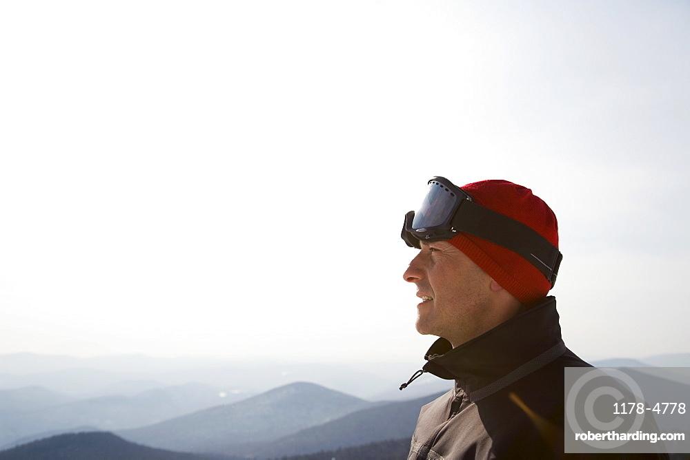 Skier at top of ski hill
