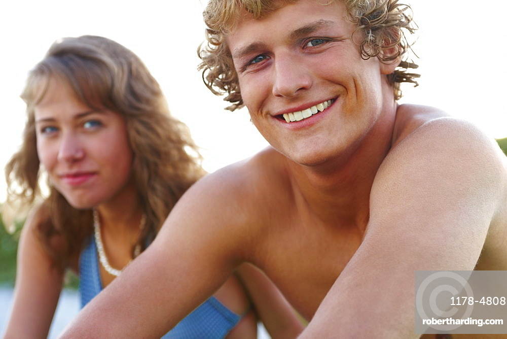 Young couple sitting at beach