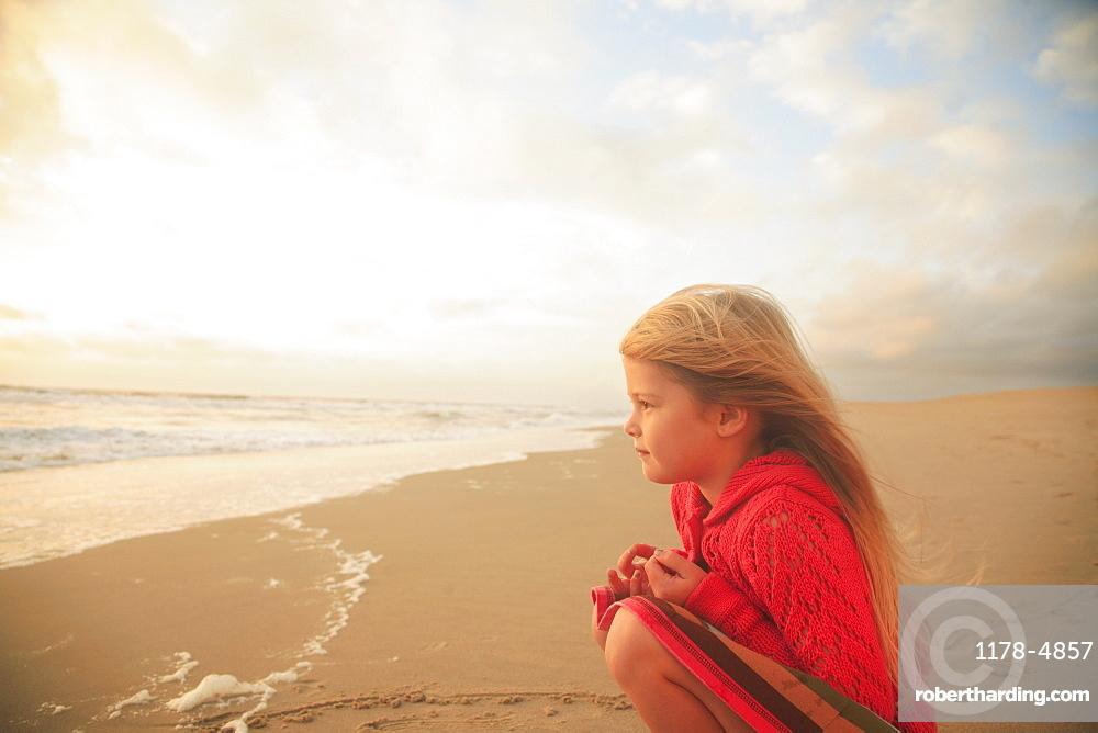 Girl sitting on beach