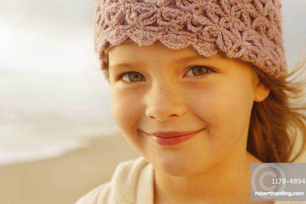 Girl wearing hat at beach