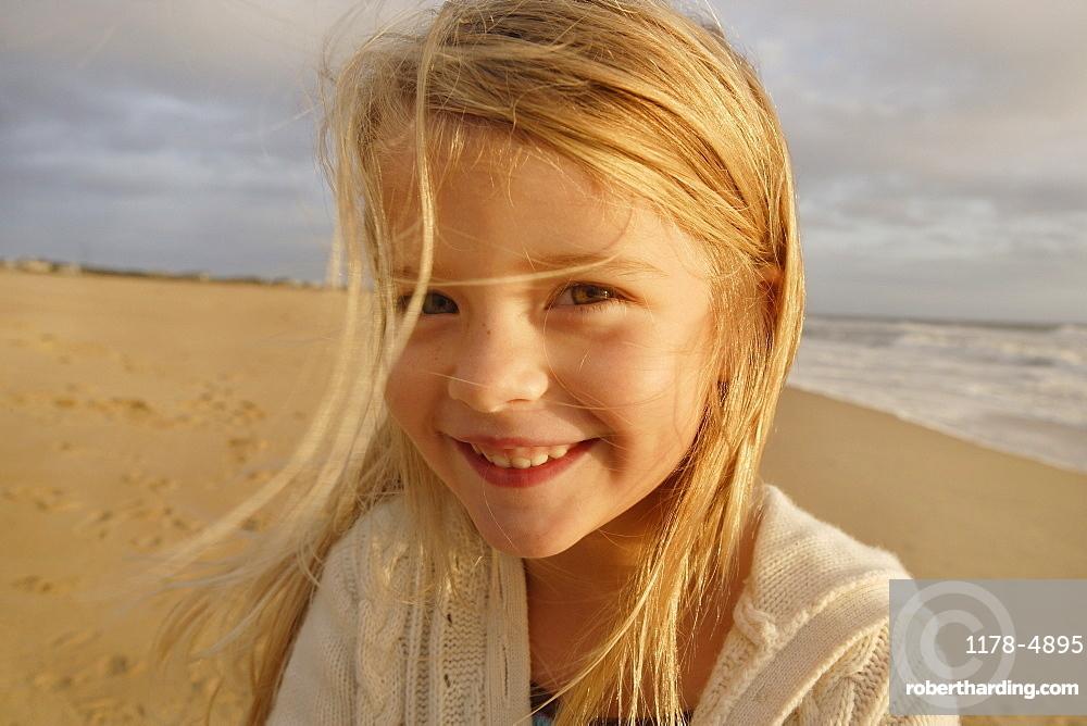 Girl laughing at beach