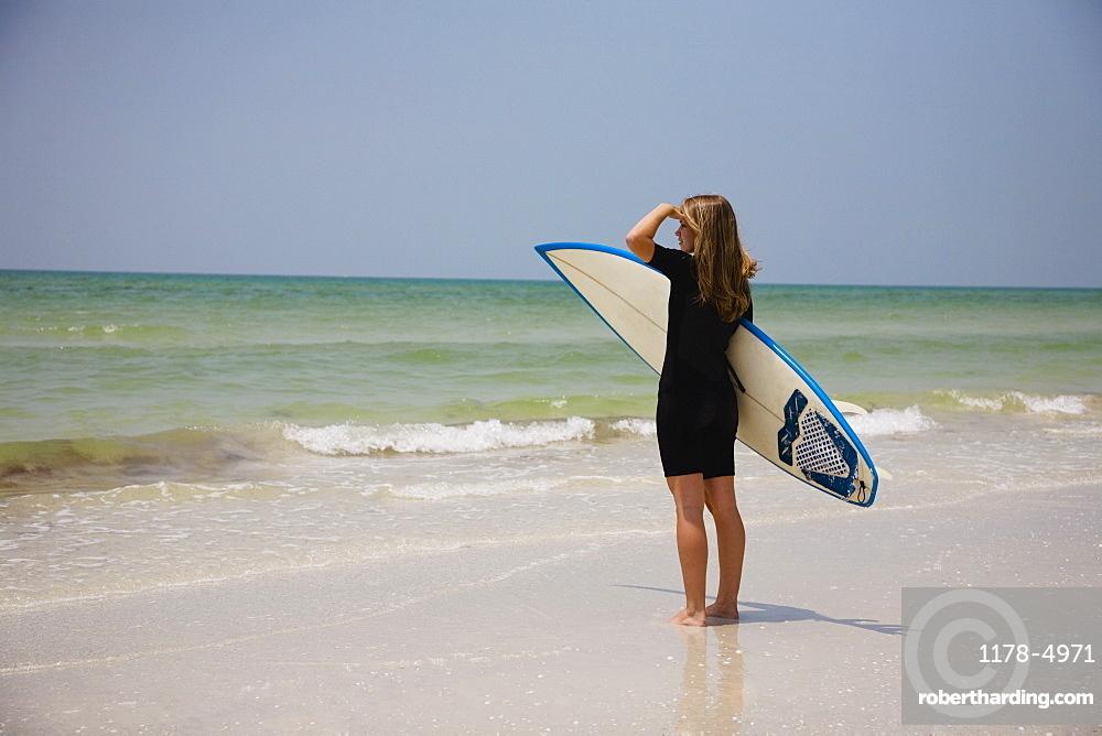 Girl holding surfboard, Florida, United States