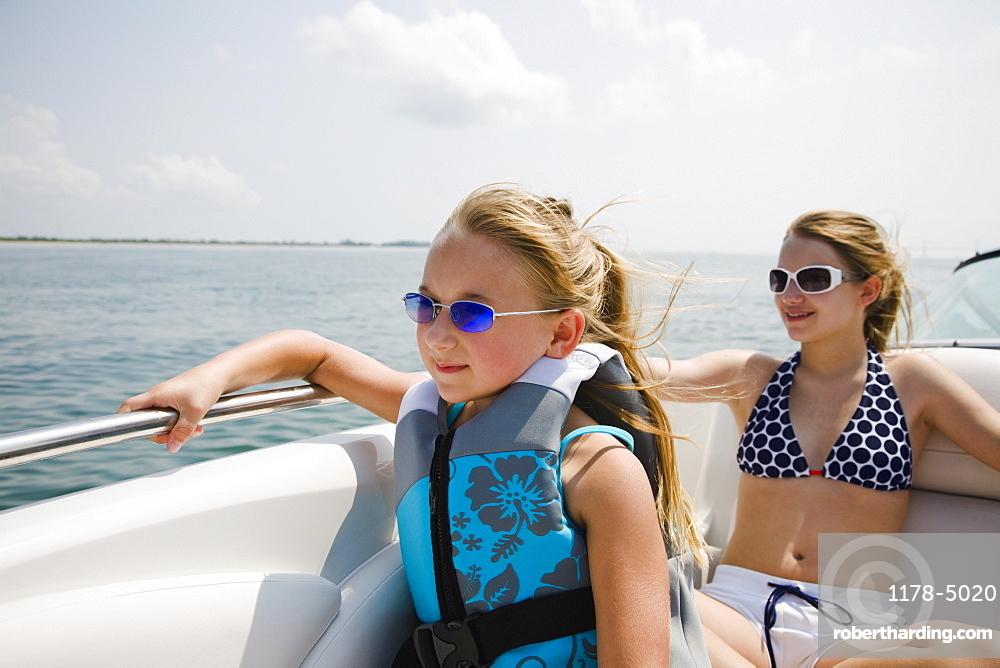 Sisters sitting on boat, Florida, United States