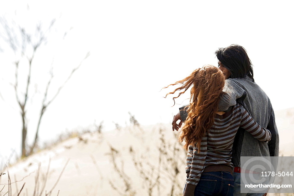 Couple embracing outdoors