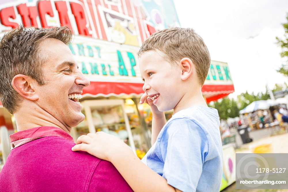 Father and son (4-5) in amusement park, USA, Utah, Salt Lake City