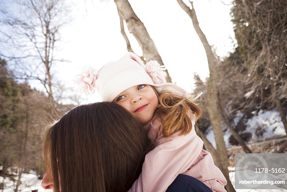 Girl (2-3) hugging her mother, USA, Utah, Highland