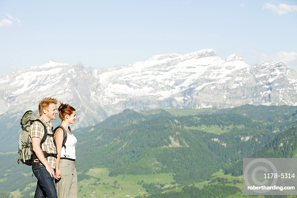 Switzerland, Leysin, Hikers marching through Alpine landscape, Switzerland, Leysin