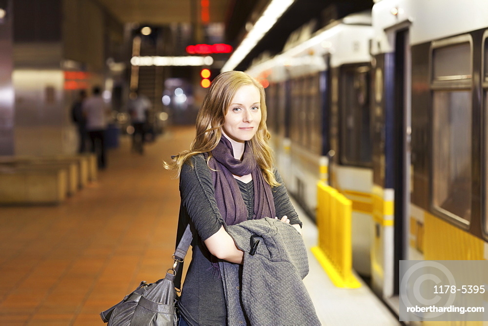 USA, California, Los Angeles, Woman standing on subway station