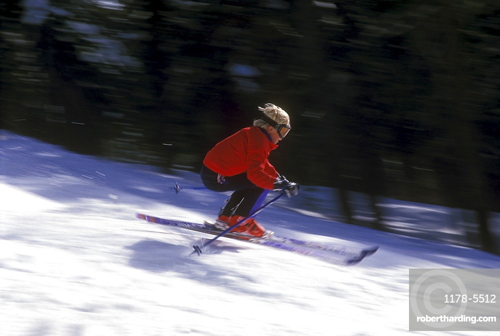 USA, California, Lake Tahoe, Boy (10-11) skiing down slope
