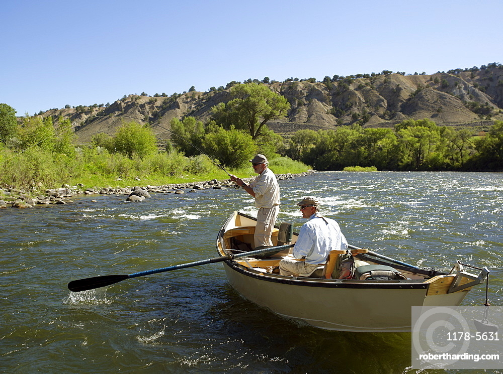 USA, Colorado, Pair of men fly-fishing on mountain river