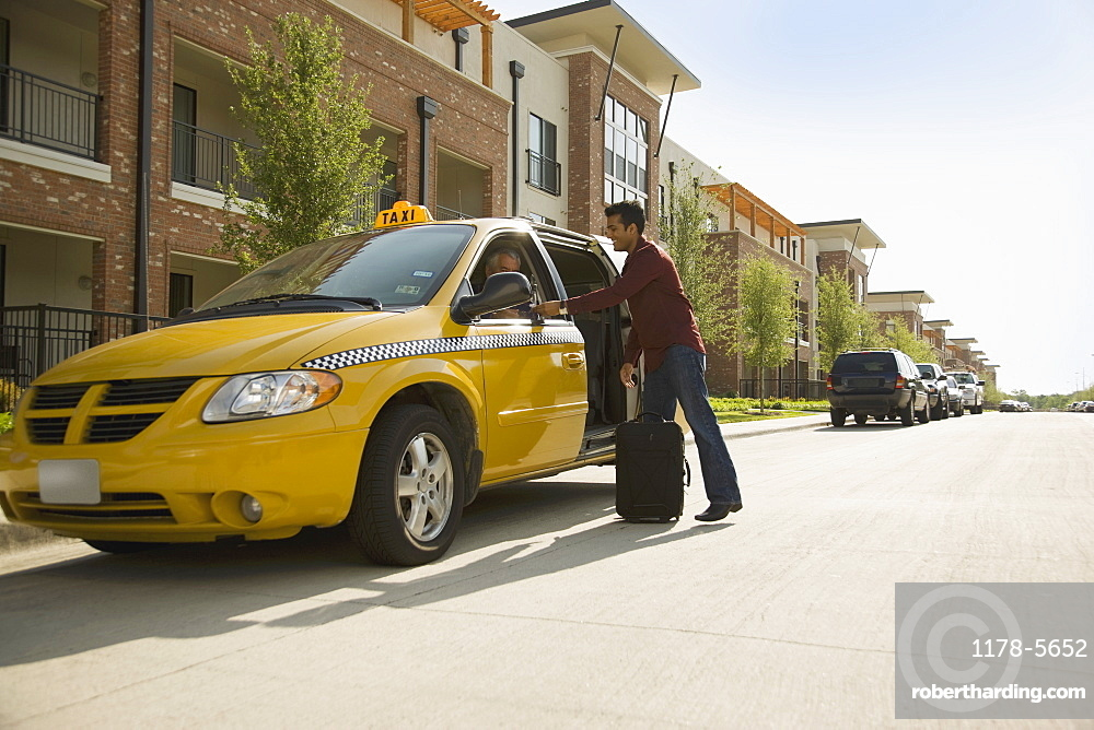 USA, Texas, Dallas, Man alighting from taxi