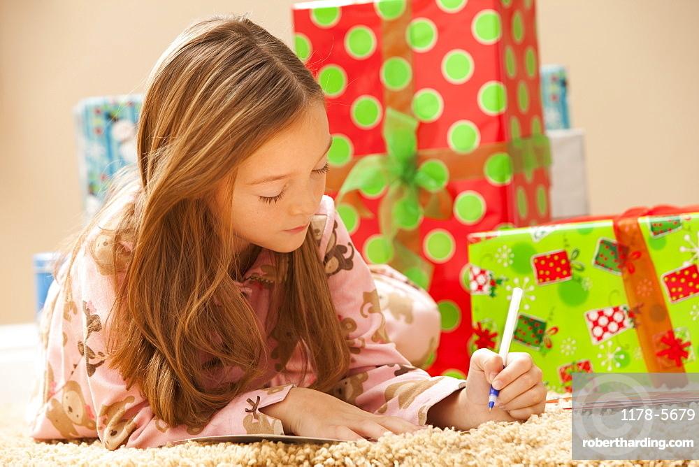 Girl (6-7) preparing Christmas presents
