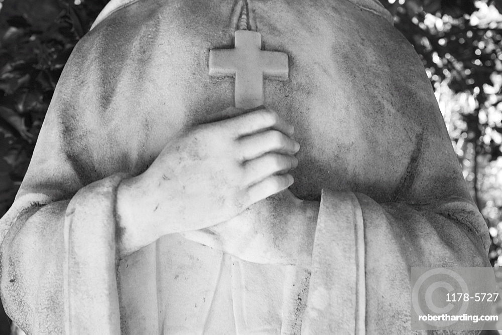 USA, Maryland, close up of statue with cross