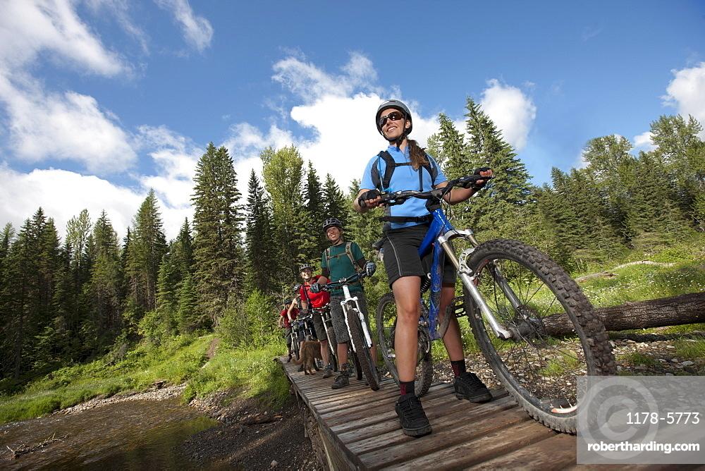 Canada, British Columbia, Fernie, Group of five people enjoying mountain biking